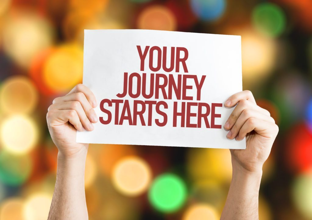 Your Journey Starts Here placard with bokeh background